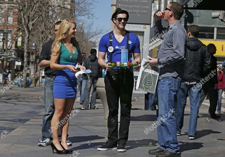 Meghan McMahon, Alex Terranova Meghan McMahon, left, and fellow model Alex Terranova hand out stickers and juice shots on an outdoor pedestrian mall, encouraging the public to get health coverage under the Affordable Care Act, during a promotional campaign launched by Colorado HealthOP, a independent non-profit health care co-op, in Denver, . More than 250,000 Coloradans have become covered through the state-run insurance exchange since enrollment began October 1, 2013, and those who still do not have health insurance have two more weeks to get coverage or pay a fine