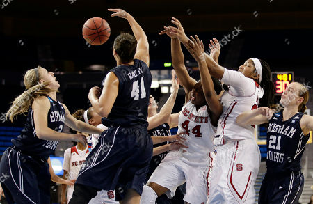 Stock Image of Ashley Garfield, Morgan Bailey, Kody Burke, Markeisha Gatling BYU's Ashley Garfield (3) and Morgan Bailey (41) fight for a rebound with North Carolina State's Kody Burke (44) and Markeisha Gatling (34) during the second half of a first-round game in the NCAA women's college basketball tournament, in Los Angeles. BYU won 72-57