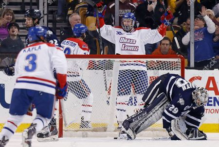 Casey DeSmith, Josh Holmstrom, A.J. White Massachusetts-Lowell's A.J. White (18) celebrates with teammate Josh Holmstrom (12) after scoring on New Hampshire's Casey DeSmith (29) in the first period of the Hockey East championship game in Boston
