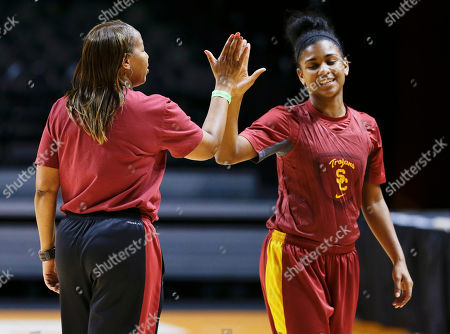 Cynthia Cooper, Destinie Gibbs Southern California head coach Cynthia Cooper, left, slaps hands with guard Destinie Gibbs, right, during practice for an NCAA women's college basketball game, in Knoxville, Tenn. Southern California will face St. John's in a first-round tournament game Saturday