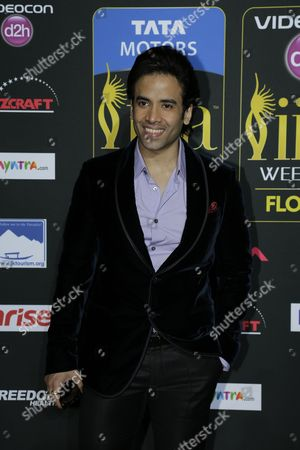 Stock Photo of Tusshar Kapoor poses for photographers as he walks the green carpet for the 15th annual International Indian Film Awards, in Tampa, Fla