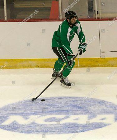 Michael Parks North Dakota forward Michael Parks skates up the rink during practice, in Cincinnati. North Dakota plays Wisconsin Friday night in an NCAA regional hockey game