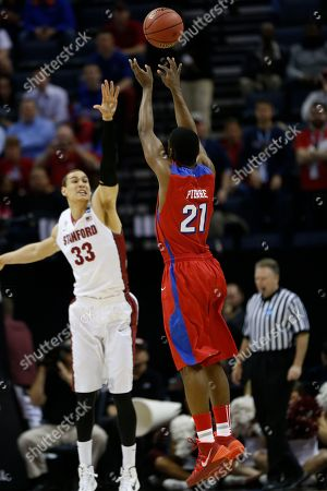 Dayton forward Dyshawn Pierre (21) shoots against Stanford forward Dwight Powell (33) during the first half in a regional semifinal game at the NCAA college basketball tournament, in Memphis, Tenn