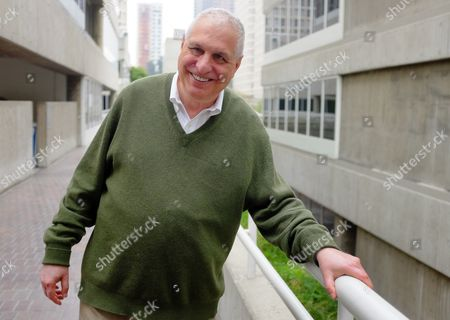 """This photo shows director Errol Morris posing for a photo in Los Angeles. Morris directed the recently released film """"The Unknown Known: The Life and Times of Donald Rumsfeld."""" Morris spent more than 30 hours interviewing Donald Rumsfeld. He sifted through thousands of memos _ """"snowflakes,"""" Rumsfeld called them _ from the former Secretary of Defense and architect of the Iraq War"""