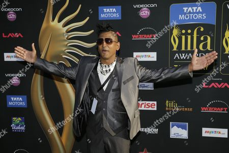 Stock Image of DJ Ravi Drums poses for photographers as he walks the green carpet for the 15th annual International Indian Film Awards, in Tampa, Fla