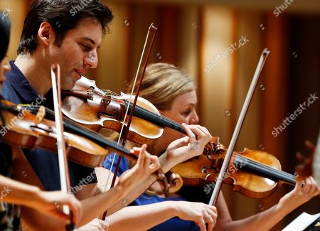 """Cho-Liang Lin, Chee-Yun, Philippe Quint, Margaret Batjer In this Thursday, March, 27, 2014 photo, three Stradivarius violins are seen, from left, South Korean Chee-Yun, plays the 1714 """"Leonora Jackson,"""" Russian-American Philippe Quint plays the 1708 """"Ruby,"""" middle and Margaret Batjer, concertmaster of the Los Angeles Chamber Orchestra, right, plays the the 1716 """"Milstein"""" during a rehearsal at the Colburn School in Los Angeles"""