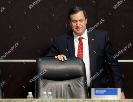 Stock Picture of Joe Carollo Doral, Fla., City Manager Joe Carollo leaves his chair in the city council chamber after being fired, in Doral, Fla. Carollo, a former mayor of Miami, was fired by a three to two vote Monday