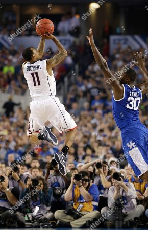 Ryan Boatright, Julius Randle Connecticut guard Ryan Boatright, left, shoots over Kentucky forward Julius Randle during the second half of the NCAA Final Four tournament college basketball championship game, in Arlington, Texas