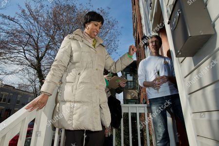Muriel Bowser, Daniel McCall D.C. Councilmember Muriel Bowser, left, one of seven Democrats trying to unseat the incumbent District of Columbia Mayor Vincent Gray in next week's primary, waves goodbye to Daniel McCall, as she goes knocking door-to-door campaigning on Capitol Hill neighborhood in Washington, . Loyalists are rallying around the mayor, and few are writing him off. But his troubles have provided an opening for one of his challengers, and D.C. Councilmember Muriel Bowser appears to be taking advantage. Two polls released a week before the primary showed Bowser in a statistical tie with Gray