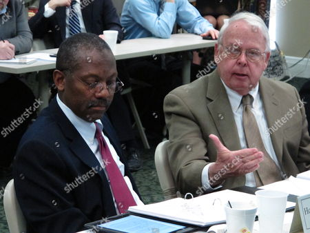 Stock Picture of Retired appeals court judge James Brogan, right, chairman of the Ohio Supreme Court death penalty review committee, addresses concerns about the layout of the panel's 71-page report as committee vice chairman, Franklin County Judge Stephen McIntosh, examines the document,, in Columbus, Ohio. The committee is reviewing 56 proposed changes to the state's death penalty law