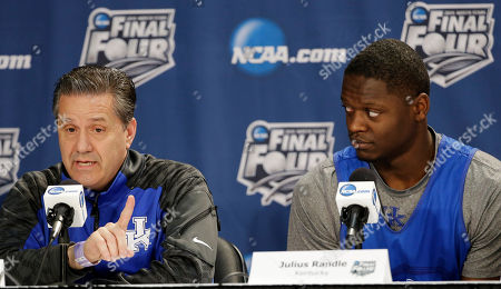 Kevin Ollie, Julius Randle Kentucky head coach John Calipari, left, answers a question as forward Julius Randle looks on during a news conference for the NCAA Final Four tournament college basketball championship game, in Arlington, Texas. Kentucky plays Connecticut in the championship game on Monday, April 7. 2014