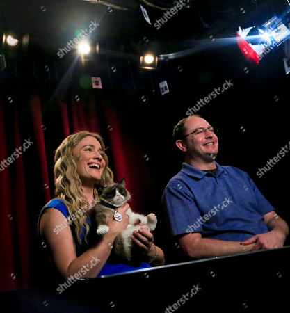 Tabatha Bundesen, left and her brother Bryan Bundesen tape an interview with Grumpy Cat, an Internet celebrity feline whose real name is Tardar Sauce, on in New York. Tabatha Bundesen says that Grumpy Cat's permanently grumpy-looking face is due to feline dwarfism