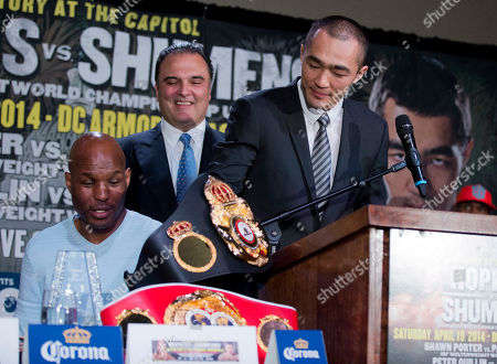 Bernard Hopkins, Beibut Shumenov, Richard Schaefer WBA and IBA light heavyweight boxing champion Beibut Shumenov, right, of Kazakhstan, takes back his championship belt that IBF light heavyweight boxing champion Bernard Hopkins, left, took from his side of the table during a news conference in Washington, about their 175-pound unification fight to be held at the DC Armory in Washington on April 19. Promoter Richard Schaefer, center, laughs