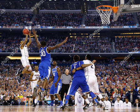 Ryan Boatright, Julius Randle Connecticut guard Ryan Boatright, left, shoots over Kentucky forward Julius Randle (30) during the second half of the NCAA Final Four tournament college basketball championship game, in Arlington, Texas