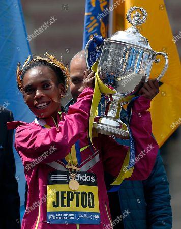 Rita Jeptoo Rita Jeptoo, of Kenya, hoists the trophy after winning the women's division of the 118th Boston Marathon in Boston