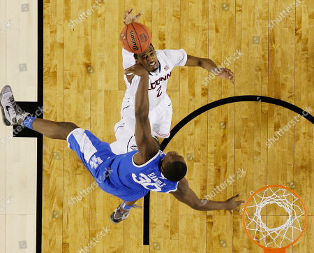 DeAndre Daniels, Julius Randle Connecticut forward DeAndre Daniels (2) shoots as Kentucky forward Julius Randle (30) defends during the first half of the NCAA Final Four tournament college basketball championship game, in Arlington, Texas