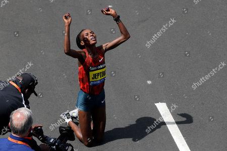 Rita Jeptoo Rita Jeptoo, of Kenya, celebrates her win in the women's division of the 118th Boston Marathon in Boston