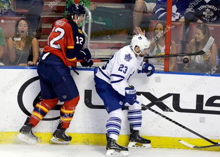 Jimmy Hayes, Trevor Smith Florida Panthers right wing Jimmy Hayes (12) and Toronto Maple Leafs center Trevor Smith (23) go for control of the puck in the second period of an NHL hockey game, in Sunrise, Fla. The Panthers defeated the Maple Leafs 4-2