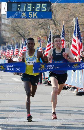 Stock Picture of Dejen Gebremeskel, left, of Ethiopia, breaks the tape ahead of Ben True, of Hanover, N.H., to win the 5-kilometer run, in Boston, in advance of Monday's 118th Boston Marathon