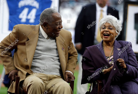 Hank Aaron, Billye Aaron Hank Aaron, left, laughs with his wife Billye, during a ceremony celebrating the 40th anniversary of his 715th home run before the start of a baseball game between the Atlanta Braves and the New York Mets, in Atlanta