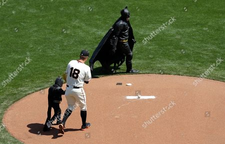 Matt Cain Miles Scott, dressed as Batkid, left, walks to the mound with San Francisco Giants pitcher Matt Cain (18) to throw the ceremonial first pitch before an opening day baseball game between the Giants and the Arizona Diamondbacks in San Francisco, . On Nov. 15, 2013, Scott, a Northern California boy with leukemia, fought villains and rescued a damsel in distress as a caped crusader through The Greater Bay Area Make-A-Wish Foundation