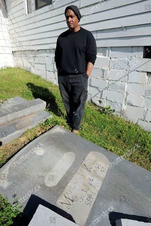 Richard Moore In a photo, Richard Moore looks at a monument he carved to civil rights protester Margaret Ann Knox at his stone shop in Meridian, Miss. Donors gave money to create a memorial they wanted to install on the courthouse lawn in Butler, Ala., but officials refused permission and the marker is now scratched and stained years later