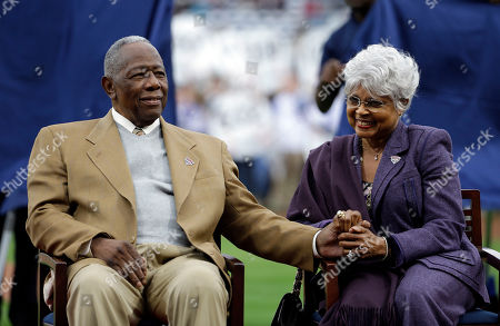 Hank Aaron, Billye Aaron Hank Aaron, left, sits with his wife Billye, during a ceremony celebrating the 40th anniversary of his 715th home run before the start of a baseball game between the Atlanta Braves and the New York Mets, in Atlanta