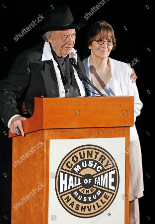 Suzi Cochran, Bobby Bare Suzi Cochran, widow of the late songwriter Hank Cochran, is introduced by Bobby Bare, left, after Hank Cochran was announced as one of three new inductees into the Country Music Hall of Fame, in Nashville, Tenn