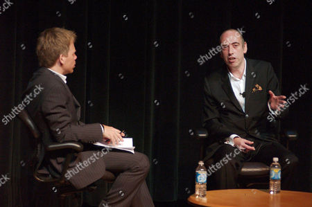Mick Jones of The Clash speaks with Warren Zanes at the opening of the 'Revolution Rock: The Story of the Clash' exhibit held at the Rock & Roll Hall of Fame and Museum