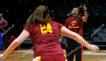 Cynthia Cooper Southern California head coach Cynthia Cooper puts her players through a drill during practice for an NCAA women's college basketball game, in Knoxville, Tenn. Southern California will play St. John's in a first-round game Saturday