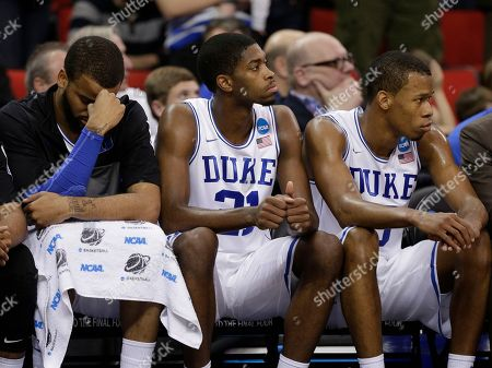 Stock Image of Duke's Josh Hairston, Amile Jefferson and Rodney Hood sit on the bench during the second half of an NCAA college basketball second-round game against Mercer, in Raleigh, N.C. Mercer won 78-71