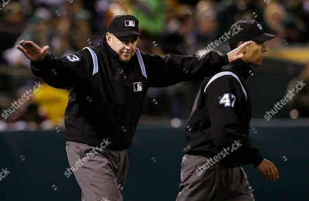 Mike Winters, Mark Wegner Umpire Mike Winters, left, signals safe next to umpire Mark Wegner (47) as he reverses the ruling that Cleveland Indians' Mike Aviles was out stealing second base against the Oakland Athletics after Indians manager Terry Francona challenged the call during the sixth inning of an MLB American League baseball game in Oakland, Calif