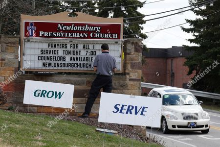 Mike Kane Mike Kane, a parishioner at the Newlonsburg Presbyterian Church in Murrysville, Pa., works on a sign outside his church that abuts the Franklin Regional School District campus, where more then a dozen people were stabbed at Franklin Regional High School, in Murrysville, Pa., near Pittsburgh. The suspect, a male student, was taken into custody and being questioned