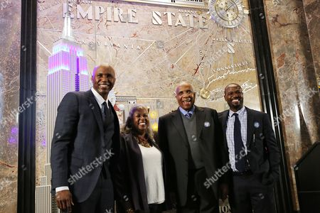 Cliff Floyd, Sharon Robinson, Frank Robinson, Harold Reynolds MLB Network analyst Cliff Floyd, Sharon Robinson, daughter of Jackie Robinson, Frank Robinson, the first African-American manager in baseball history, and MLB Network analyst Harold Reynolds, from left to right, are shown during a lighting ceremony at the Empire State Building in honor of Jackie Robinson Day, in New York City