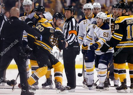 Daniel Paille, Tyler Ennis Buffalo Sabres' Tyler Ennis (63) reaches out as Boston Bruins' Daniel Paille (20) struggles to stand during the third period of an NHL hockey game in Boston, . Paille was helped from the ice after falling hard when he collided with the Sabres' Jake McCabe. The Bruins won 4-1
