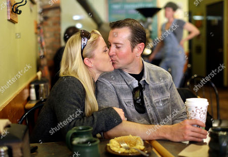 Kurt Busch Race car driver Kurt Busch, right, kisses his girlfriend Patricia Driscoll at a coffee shop in Ellicott City, Md. Police in Delaware say they are investigating a domestic assault allegation made against NASCAR driver Kurt Busch. The Dover Police Department said in a statement, that the allegations were brought to the department on Wednesday. His ex-girlfriend, Patricia Driscoll, said the allegations involved an incident inside his motorhome at a race