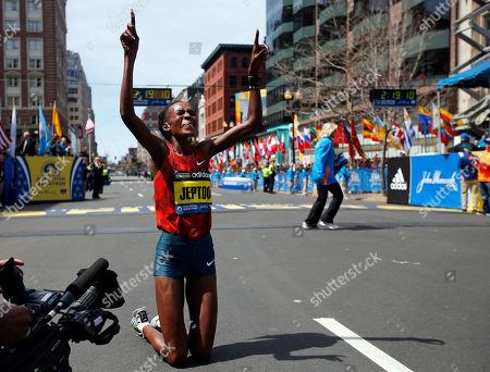 Rita Jeptoo 10ThingstoSeeSports - Rita Jeptoo, of Kenya, celebrates her win in the women's division of the 118th Boston Marathon, in Boston