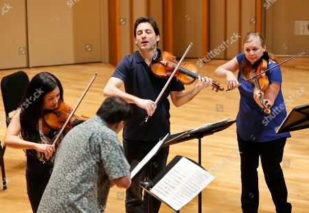 """Chee-Yun, Cho-Liang Lin, Philippe Quint, Margaret Batjer In this Thursday, March, 27, 2014 photo, four Stradivarius violins are played on stage, from left, South Korean Chee-Yun, plays the 1714 """"Leonora Jackson,"""" Taiwanese American Cho-Liang Lin, plays the 1715 """"Titian,"""" Russian-American Philippe Quint plays the 1708 """"Ruby,"""" and Margaret Batjer, concertmaster of the Los Angeles Chamber Orchestra, plays the the 1716 """"Milstein"""" during a rehearsal at the Colburn School in Los Angeles. The violins of Antonio Stradivari, arguably the most famous instruments ever created, have an almost mystical reputation for beauty and heavenly tone. This week eight of them have been brought together in the City of Angels. """"Strad Fest LA"""