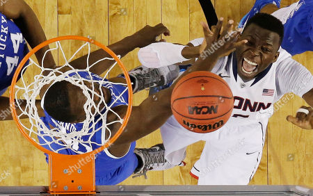 Julius Randle, Amida Brimah Kentucky forward Julius Randle, left, and Connecticut center Amida Brimah go after the ball during the second half of the NCAA Final Four tournament college basketball championship game, in Arlington, Texas