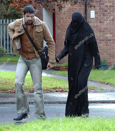 Aishah Azmi leaving her flat with her husband Ahmed Khan. Shahid Malik, the MP for Dewsbury, asks Aishah Azmi to drop the argument that she was discriminated against for her islamic faith