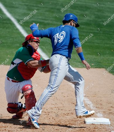 Carlos Ruiz, Jose Bautista Toronto Blue Jays' Jose Bautista (19) is picked off at first by Philadelphia Phillies catcher Carlos Ruiz (51) in the sixth inning of a spring exhibition baseball game in Clearwater, Fla., . The Jays defeated the Phillies 3-1