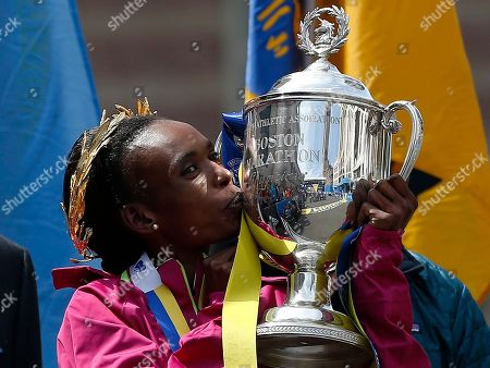 Rita Jeptoo Rita Jeptoo, of Kenya, kisses the trophy after winning the women's division of the 118th Boston Marathon in Boston. Kenyan marathoner Rita Jeptoo will have to wait up to three more months to learn the outcome of the hearing into her positive doping test. Athletics Kenya requested more time for further investigation after the three-time Boston Marathon champion and two-time Chicago Marathon winner appeared at a hearing Thursday Jan. 15, 2015. Jeptoo could face a ban of two or four years if found guilty of doping