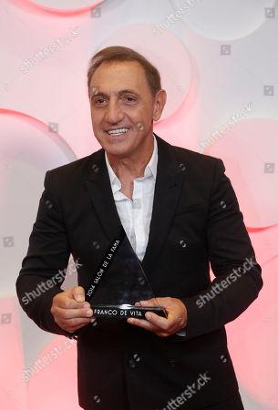 Stock Photo of Franco de Vita Singer Franco de Vita holds the Hall of Fame Award during the Latin Billboard Awards, in Coral Gables, Fla