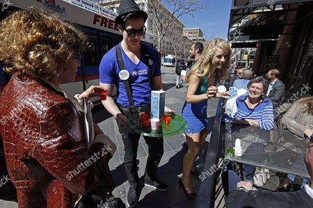 Meghan McMahon, Alex Terranova Meghan McMahon and fellow model Alex Terranova hand out stickers and juice on an outdoor pedestrian mall, encouraging the public to get health coverage under the Affordable Care Act, during a promotional campaign launched by Colorado HealthOP, a independent non-profit health care co-op, in Denver, . More than 250,000 Coloradans have become covered through the state-run insurance exchange since enrollment began October 1, 2013, and those who still do not have health insurance have two more weeks to get coverage or pay a fine