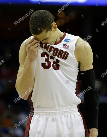 Stanford forward Dwight Powell (33) reacts after a Stanford foul against Dayton during the second half in a regional semifinal game at the NCAA college basketball tournament, in Memphis, Tenn