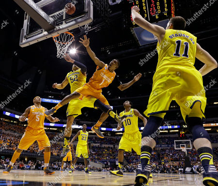 Josh Richardson, Jordan Morgan Tennessee's Josh Richardson (1) Michigan's Jordan Morgan (52) go after a loose ball during the first half of an NCAA Midwest Regional semifinal college basketball tournament game, in Indianapolis