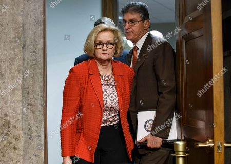 Stock Image of Claire McCaskill, Joe Manchin Senate Armed Services Committee members Sen. Claire McCaskill, D-Mo., left, and Sen. Joe Manchin, D-W. Va., emerge from a private meeting with Secretary of the Army John M. McHugh, left, and Army Chief of Staff Gen Raymond Odierno who updated the panel on the deadly shooting rampage by an Iraq War veteran yesterday at Fort Hood in Texas, on Capitol Hill in Washington