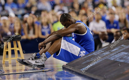 Julius Randle Kentucky forward Julius Randle sits on the sideline during the second half of the NCAA Final Four tournament college basketball championship game against Connecticut, in Arlington, Texas