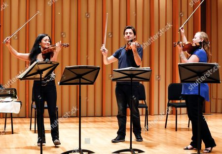 """Chee-Yun, Philippe Quint, Margaret Batjer In this Thursday, March, 27, 2014 photo, Stradivarius violins are played on stage, from left, South Korean Chee-Yun, plays the 1714 """"Leonora Jackson,"""" Russian-American Philippe Quint plays the 1708 """"Ruby,"""" and Margaret Batjer, concertmaster of the Los Angeles Chamber Orchestra, plays the the 1716 """"Milstein"""" during a rehearsal at the Colburn School in Los Angeles. The violins of Antonio Stradivari, arguably the most famous instruments ever created, have an almost mystical reputation for beauty and heavenly tone. This week eight of them have been brought together in Los Angeles for """"Strad Fest LA"""
