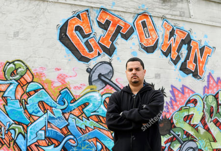Angel Arroyo This, photo shows Angel Arroyo standing in front of a graffiti covered wall in Cleveland. Arroyo and the father of Gina DeJesus, who was freed in May 2013 after 10 years of captivity by Ariel Castro, went to door-to-door last summer after a young woman went missing in a neighboring city. Finding DeJesus, Amanda Berry and Michelle Knight generated new tips other girls who disappeared years ago in the same area